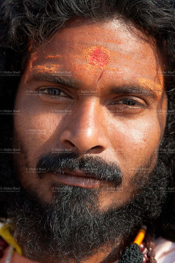 India. Uttar Pradesh state. Allahabad. Maha Kumbh Mela. An Indian Hindu devotee with a tilaka on the front head. In Hinduism, the tilaka, tika or tilakam or tilak is a mark created by the smearing of powder or paste and worn on the forehead. Tilaka may be worn on a daily basis or for special religious occasions. The Kumbh Mela, believed to be the largest religious gathering is held every 12 years on the banks of the 'Sangam'- the confluence of the holy rivers Ganga, Yamuna and the mythical Saraswati. In 2013, it is estimated that nearly 80 million devotees took a bath in the water of the holy river Ganges. The Maha (great) Kumbh Mela, which comes after 12 Purna Kumbh Mela, or 144 years, is always held at Allahabad. Uttar Pradesh (abbreviated U.P.) is a state located in northern India. 10.02.13 © 2013 Didier Ruef