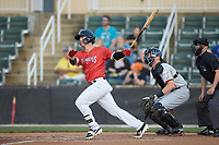 Romy Gonzalez (6) of the Piedmont Boll Weevils follows through on his swing against the Hickory Crawdads at Kannapolis Intimidators Stadium on May 3, 2019 in Kannapolis, North Carolina. The Boll Weevils defeated the Crawdads 4-3. (Brian Westerholt/Four Seam Images)