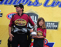May 1, 2011; Baytown, TX, USA: NHRA top fuel dragster driver Del Worsham celebrates with his daughter after winning the Spring Nationals at Royal Purple Raceway. Mandatory Credit: Mark J. Rebilas-