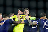 21st September 2021; Craven Cottage, Fulham, London, England; EFL Cup Football Fulham versus Leeds; Junior Firpo of Leeds United and the rest of the Leeds United players celebrates with Goalkeeper Illan Meslier of Leeds United he saved a penalty from Rodrigo Muniz of Fulham to win the penalty shoot out