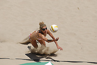 Huntington Beach, CA - 5/6/07:  April Ross dives for the ball during Boss / Ross' 21-14, 21-16 loss to Branagh / Youngs in the semifinals of the AVP Cuervo Gold Crown Huntington Beach Open of the 2007 AVP Crocs Tour..Photo by Carlos Delgado