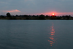 Sun setting over river, Kafue River, Kafue National Park, Zambia
