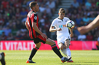 Tom Carroll of Swansea City is marked by Dan Gosling of Bournemouth during the Premier League match between AFC Bournemouth and Swansea City at Vitality Stadium in Bournemouth, England, UK. Saturday 05 May 2018