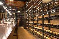 Wine rack with a collection of rare first growth clarets of all available vintages in a tasting room with wine glasses on a wooden table. Ulriksdal Ulriksdals Wärdshus Värdshus Wardshus Vardshus Restaurant, Stockholm, Sweden, Sverige, Europe