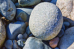 Round rocks, boulders, on beach at Fort Ebey State Park.  Whibey Island, WA.