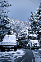 Pictured: Snow covered cars in Lycabetus Hill and the Acropolis is covered in snow in Athens, Greece. Tuesday 10 January 2017<br /> Re: Heavy snow fall and minus zero temperatures have affected most parts of eastern Europe and Greece.