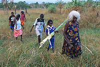 Peace Woolla leading a group of Aurukun women gathering pandanus leaf, Aurukun, Cape York Peninsula.