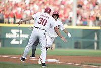 Arkansas infielder Robert Moore (1) runs home for a score, Monday, June 7, 2021 in the NCAA Fayetteville Regional at Baum-Walker Stadium in Fayetteville. Check out nwaonline.com/210608Daily/ for today's photo gallery. <br /> (NWA Democrat-Gazette/Charlie Kaijo)