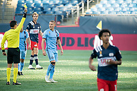 FOXBOROUGH, MA - SEPTEMBER 19: Referee Ramy Touchan issues a yellow card to Alexander Ring #8 of New York City FC during a game between New York City FC and New England Revolution at Gillette on September 19, 2020 in Foxborough, Massachusetts.