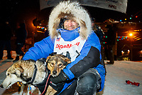 Geir Idar Hjelvik poses with his lead dogs at the finish line in Nome arriving in 45th place during the 2017 Iditarod on Friday March 17, 2017.<br /> <br /> Photo by Jeff Schultz/SchultzPhoto.com  (C) 2017  ALL RIGHTS RESERVED