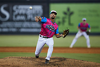 Pescados de Carolina outfielder Noah Campbell (8) pitches in relief during the game against the Delmarva Shorebirds at Five County Stadium on September 4, 2021 in Zebulon, North Carolina. (Brian Westerholt/Four Seam Images)