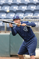 Alex Jackson (10) of the Everett AquaSox practices bunting before a game against the Spokane Indians at Everett Memorial Stadium on July 25, 2015 in Everett, Washington. Spokane defeated Everett, 10-1. (Larry Goren/Four Seam Images)