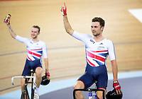 06 DEC 2014 - STRATFORD, LONDON, GBR - Owain Doull (GBR) of Great Britain and his team mate Mark Christian (GBR) (left) celebrate their victory in the 2014 UCI Track Cycling World Cup Madison race at the Lee Valley Velo Park in Stratford, London, Great Britain  (PHOTO COPYRIGHT © 2014 NIGEL FARROW, ALL RIGHTS RESERVED)