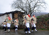 "A group of ""Joaldun"" march carrying sheep furs and big cowbells on their backs on January 27, 2014 at the village of Ituren, Basque Country. Joaldun groups perform an ancient traditional carnival at the villages of Ituren and Zubieta during two days, carrying sheep furs and big cowbells in their backs and making sound them in order to wake up the earth, to ask for a good new year, a good harvest and also to keep away the bad spirits. (Ander Gillenea / Bostok Photo)"