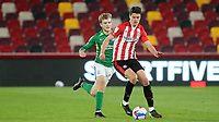 Christian Norgaard of Brentford shields the ball from Birmingham's Riley McGree during Brentford vs Birmingham City, Sky Bet EFL Championship Football at the Brentford Community Stadium on 6th April 2021