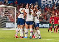 HOUSTON, TX - JUNE 10: Christen Press #23, Crystal Dunn #19 and Samantha Mewis #3 of the USWNT celebrate a goal during a game between Portugal and USWNT at BBVA Stadium on June 10, 2021 in Houston, Texas.