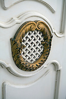Detail of a carved and gilded decoration on the door of the wardrobe