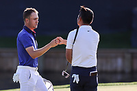 14th March 2021; Ponte Vedra Beach, Florida, USA;  Justin Thomas of the United States gives a fist bump to Doug Ghim of the United States after the final round of THE PLAYERS Championship on March 14, 2021 at TPC Sawgrass Stadium Course in Ponte Vedra Beach, Fl.