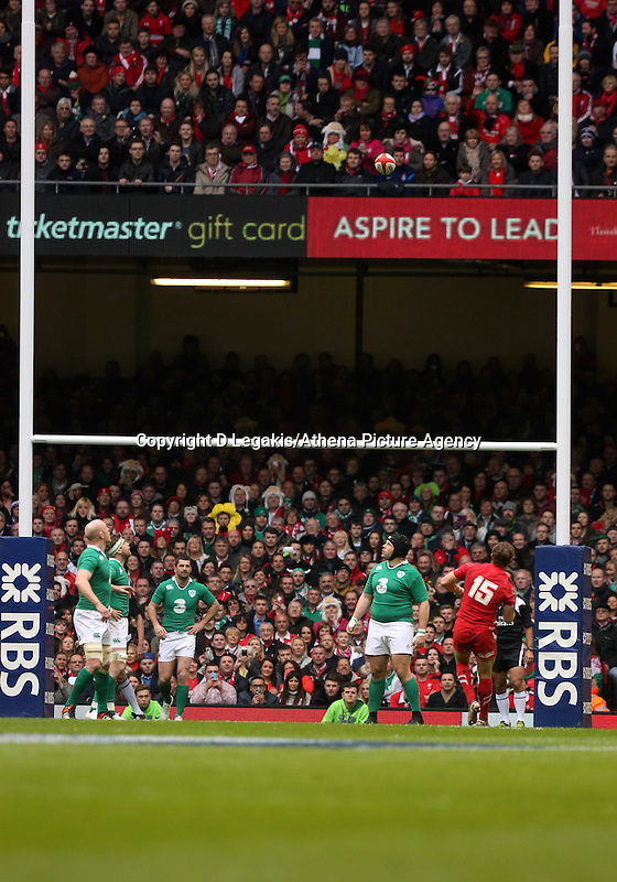 Pictured: Leigh Halfpenny of Wales (15) scores a penalty Saturday 14 March 2015<br /> Re: RBS Six Nations, Wales v Ireland at the Millennium Stadium, Cardiff, south Wales, UK.