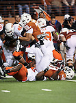 Texas Longhorns running back Cody Johnson (31) gets tackled by Oklahoma State Cowboys linebacker Orie Lemon (41) during the game between the Oklahoma State Cowboys and the University of Texas in Austin Texas Longhorns at the Daryl K. Royal- Texas Memorial Stadium in Austin, Texas. The Oklahoma State Cowboys defeated the Texas Longhorns 33 to 16.