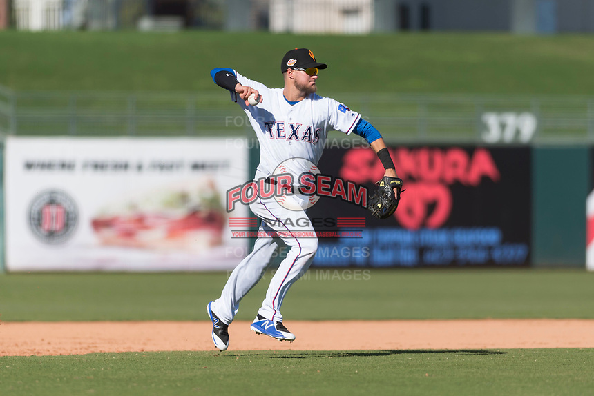 Surprise Saguaros third baseman Charles Leblanc (12), of the Texas Rangers organization, throws to first base during an Arizona Fall League game against the Peoria Javelinas at Surprise Stadium on October 17, 2018 in Surprise, Arizona. (Zachary Lucy/Four Seam Images)