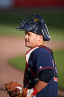 Lehigh Valley IronPigs catcher Andrew Knapp (15) warms up before a game against the Buffalo Bisons on July 9, 2016 at Coca-Cola Field in Buffalo, New York.  Lehigh Valley defeated Buffalo 9-1 in a rain shortened game.  (Mike Janes/Four Seam Images)