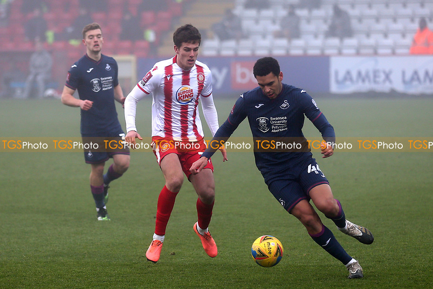 Charlie Carter of Stevenage and Ben Cabango of Swansea City during Stevenage vs Swansea City, Emirates FA Cup Football at the Lamex Stadium on 9th January 2021