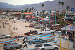 Crowds fill the street,beach and boardwalk (malecon,) during Spring Break<br />