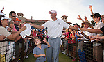 Matt Kuchar and his 4 year-old son Cameron hand out souvenirs after winning THE PLAYERS Championship PGA golf tournament in Ponte Vedra Beach, Florida on May 13, 2012.