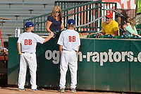 Two of the ball boys from the Ogden Raptors talk to the fans as the Raptors prepare to take on the Helena Brewers at Lindquist Field in Pioneer League play on July 23, 2013 in Ogden Utah. (Stephen Smith/Four Seam Images)