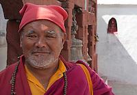 Bodhnath, Nepal.   Monk at the Buddhist Stupa of Bodhnath.
