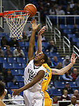 Nevada's D.J. Fenner gets fouled by Northwest Christian's Austin Kuemper during a college basketball game in Reno, Nev., on Sunday, Dec. 28, 2014. Nevada won 81-67.<br /> Photo by Cathleen Allison