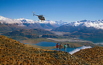 Hughes 500 Helicopter and tourists above Lake Wanaka Otago New Zealand