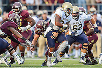Navy full back Noah Copeland (34) attempts to break tackle by Texas State linebacker David Mayo (3) during NCAA Football game, Saturday, September 13, 2014 in San Marcos, Tex. Navy defeated Texas State 35-21.(Mo Khursheed/TFV Media via AP Images)