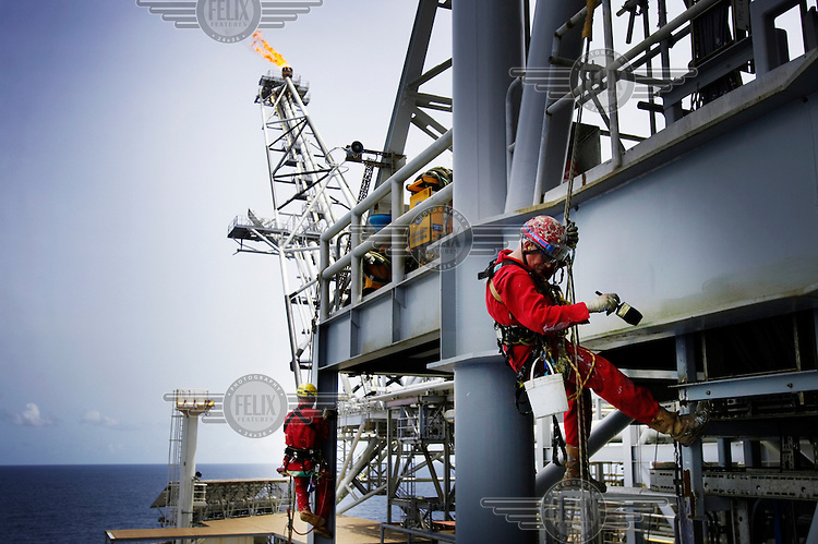 Shell oil workers on the Bonga oil and gas platform, which is located over 100 km offshore.