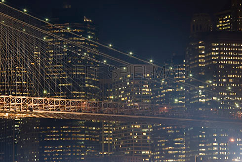 THIS IMAGE IS AVAILABLE EXCLUSIVELY FROM GETTY IMAGES.....Please search for image # 200535106-001 on www.gettyimages.com....Brooklyn Bridge and Office Buildings in Lower Manhattan's Financial District Illuminated at Night, New York City, New York State, USA