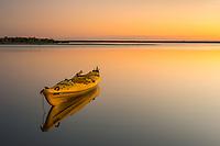 Sunset scene with kayak in Okarito Lagoon, Westland Tai Poutini National Park, West Coast, UNESCO World Heritage Area, South Westland, New Zealand, NZ