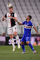 Matthijs de Ligt of Juventus and Fabio Quagliarella of UC Sampdoria compete for the ball during the Serie A football match between Juventus FC and UC Sampdoria at Juventus stadium in Turin (Italy), July 26th, 2020. Play resumes behind closed doors following the outbreak of the coronavirus disease. <br /> Photo Federico Tardito / Insidefoto