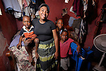 """The Social Mission of the Haitian Church (MISSEH) has helped 1200 people move out of the crowded Prophecie camp for survivors of the devastating January 2010 earthquake. Among them is Yvette Chery and her three boys, seen here living in their one-room apartment in Port-au-Prince which they abandoned after the quake. MISSEH has accompanied Chery and other families returning to their damaged former homes, helping them deal with fear that the earth will start trembling once again. """"I am still afraid, though not every day. I'm trying to live with it,""""  she says. MISSEH's work is supported by Norwegian Church Aid and Church World Service, members of the ACT Alliance."""