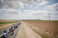 the peloton train rolling through the open fields of Northren France<br /> <br /> Stage 3: Binche (BEL) to Épernay (FRA) (214km)<br /> 106th Tour de France 2019 (2.UWT)<br /> <br /> ©kramon