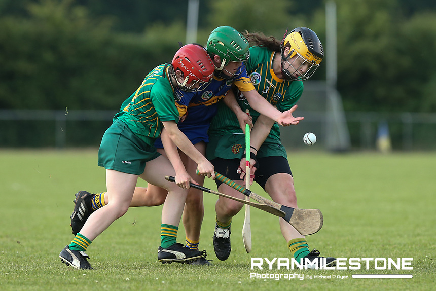 Tipperary's Casey Hennessy in action against Claire Coffey and Sofia Payne of Meath during the Liberty Insurance All Ireland Senior Camogie Championship Round 1 between Tipperary and Meath at the Ragg, Co Tipperary. Photo By Michael P Ryan.
