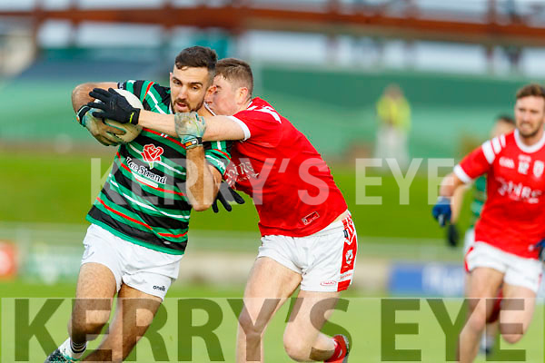 David Griffin, St. Brendan's Board in action against Ronan Buckley, East Kerry during the Kerry County Senior Football Championship Semi-Final match between East Kerry and St Brendan's at Austin Stack Park in Tralee, Kerry.