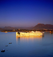 Scenic view of lake, palace, mountains, Udaipur (aka Mewar, Rajasthan), India. Landscape. Udaipur, Rajasthan India Asia.