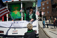 Parade participants wait by floats before the start of the St. Patrick's Day Parade in South Boston, Massachusetts.
