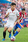 Carlos Joaquin Correa (l) of Sevilla FC competes for the ball with Jorge Resurreccion Merodio, Koke, of Atletico de Madrid during their La Liga match between Atletico de Madrid and Sevilla FC at the Estadio Vicente Calderon on 19 March 2017 in Madrid, Spain. Photo by Diego Gonzalez Souto / Power Sport Images