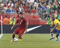 Portugal forward Nelson Oliveira (9) controls the ball. In an international friendly, Brazil (yellow/blue) defeated Portugal (red), 3-1, at Gillette Stadium on September 10, 2013.