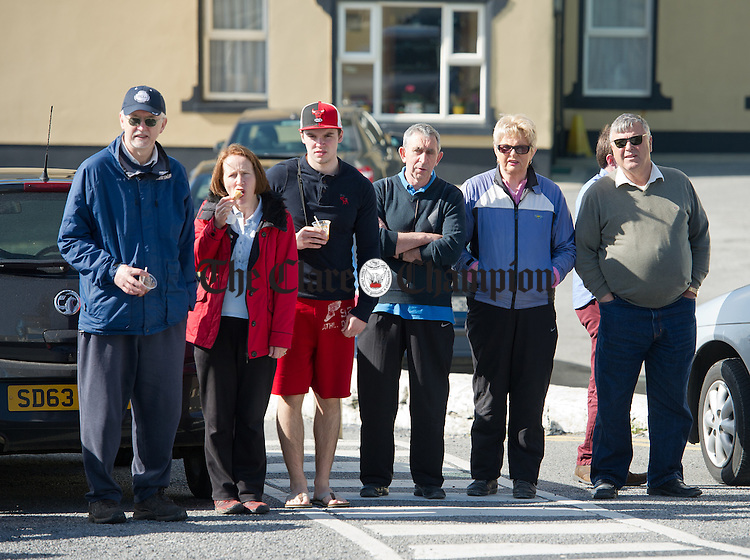 Supporters watch as the cyclists arrive in Lahinch during the second day of the Clare 250 Cycle. Photograph by John Kelly.