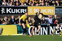 Joe Simpson of London Wasps sends up a box kick during the Aviva Premiership match between London Wasps and Saracens at Adams Park on Saturday 29th March 2014 (Photo by Rob Munro)