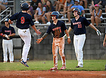 Nick Couch (9) of the Greer Warhawks hops into the air as he is greeted by Truman Roper (1) and Collin Fowler (21) after scoring a run in a South Carolina American League game against Easley on Thursday, July 16, 2020, at Stevens Field in Greer, South Carolina. Greer won, 9-4. (Tom Priddy/Four Seam Images)