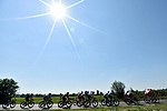 The peloton lined out during the 111th edition of Milan- San Remo 2020, running 305km from Milan to San Remo, Italy. 8th August 2020.<br /> Picture: LaPresse/Fabio Ferrari | Cyclefile<br /> <br /> All photos usage must carry mandatory copyright credit (© Cyclefile | LaPresse/Fabio Ferrari)